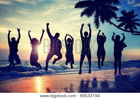 Young People Jumping with Excitement on a Beach