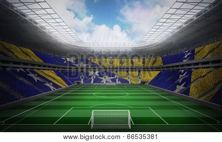 Digitally generated bosnian flag against football stadium