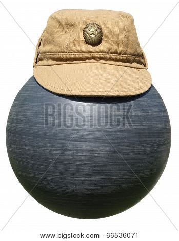 Military Khaki Cap On The Plastic Ball Black Isolated On White Background.
