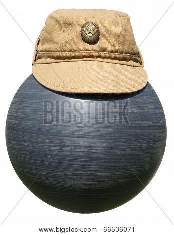 Military Khaki Cap On The Plastic Ball Black Isolated On White Background.