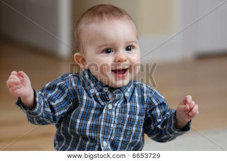 Dancing caucasian baby boy