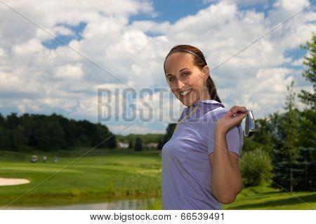 Woman Golfer Stretching With A Golf Club