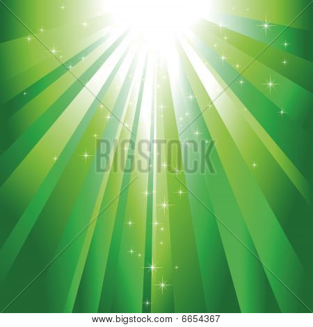 Sparkling stars descending on green light burst
