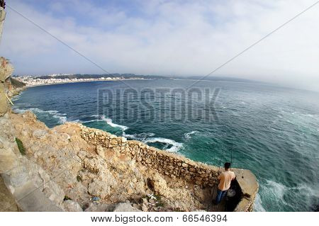 Fishing On The Coast Of Nazare, Portugal