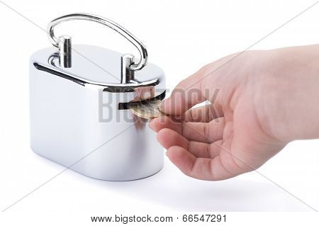Child hand inserts one Turkish Lira in money box isolated on white background