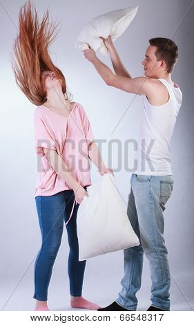 Young Couple Having Pillow Fight