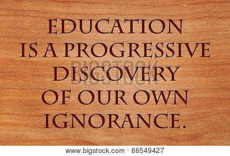 Education is a progressive discovery of our own ignorance - quote on wooden red oak background