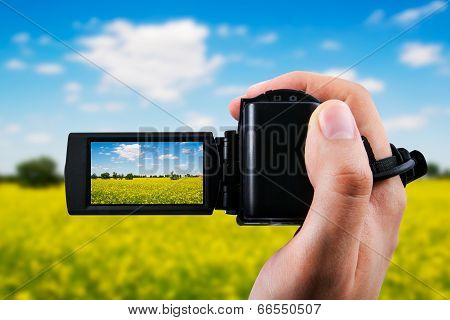 Video Camera Or Camcorder Recording Yellow Field And Blue Sky