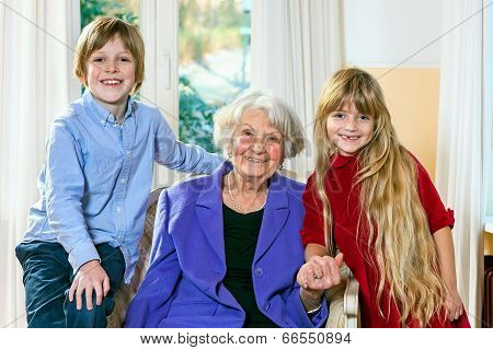 Grandmother Posing With Her Two Grandchildren