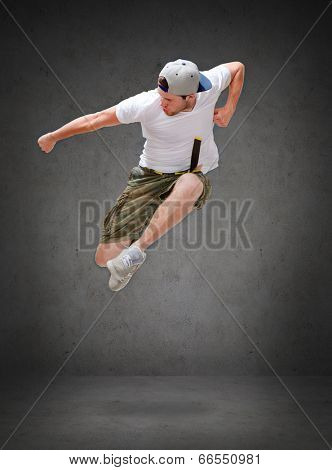 dancing, happiness and people concept - male dancer jumping in the air