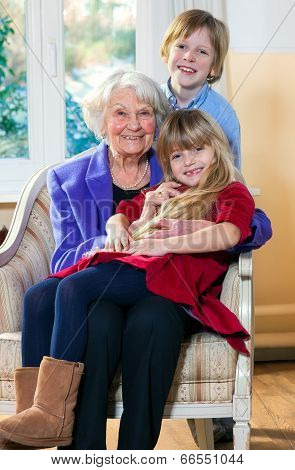 Grandmother With Two Children Having Fun
