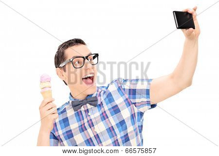 Excited man holding ice cream and taking selfie isolated on white background