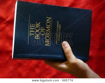 Holding The Book Of Mormon