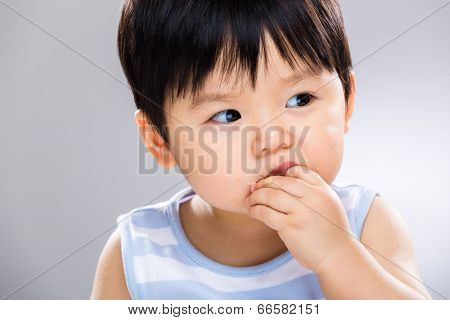 Asian baby boy eat biscuit