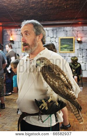 MUSKOGEE, OK - MAY 24: Handler shows a bird of prey at the Oklahoma 19th annual Renaissance Festival on May 24, 2014 at the Castle of Muskogee in Muskogee, OK
