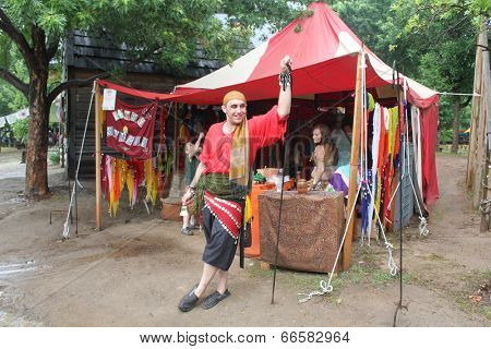 MUSKOGEE, OK - MAY 24: Merchant shows off  crafts for sale at the Oklahoma 19th annual Renaissance Festival on May 24, 2014 at the Castle of Muskogee in Muskogee, OK
