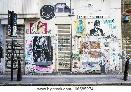 LONDON, UK - APRIL 18, 2014: Graffiti, posters and stickers on Fashion Street, Spitalfields / Whitechapel.