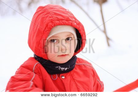 Little Kid In Red Jacket