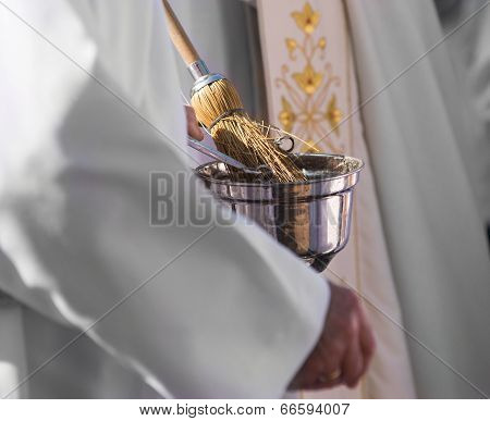 Catholic Priest With Holy Water
