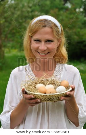 Young woman and Easter eggs - Easter time
