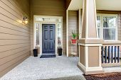 pic of flower pots  - Entrance porch with black door column and railings - JPG