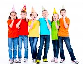 foto of blowers  - Group of happy children in colored t - JPG