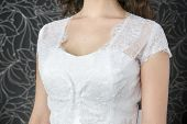 pic of cleavage  - Lace white wedding dress closeup - JPG