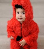 Young boy in fluffy red costume poster