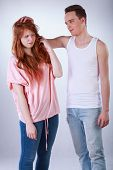 pic of tease  - Teenage boy teasing her female colleague vertical - JPG