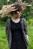 picture of revolt  - Crazy young girl with dreadlocks on the outside - JPG