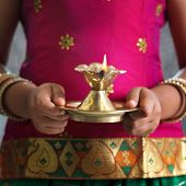 picture of deepavali  - Diwali or deepavali photo with female hands holding oil lamp during festival of light - JPG