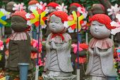 stock photo of shogun  - Jizo Statues for the unborn children at Zojoji Temple in Tokyo