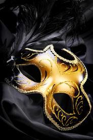 picture of mardi gras mask  - Ornate carnival mask on black silk background - JPG