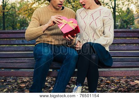 Couple Opening Heart Shaped Box