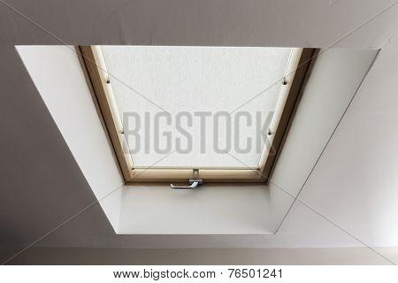 Mansarde window in an attic