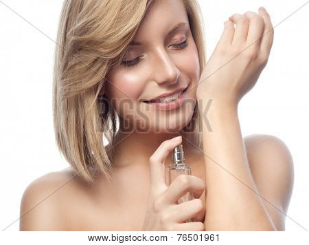 portrait of attractive young caucasian smiling woman isolated on white studio shot applying parfume face closeup beauty