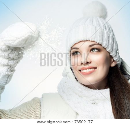 closeup portrait of attractive  caucasian smiling woman brunette isolated on white studio shot lips toothy smile face hair head and shoulders snowflake winter christmas