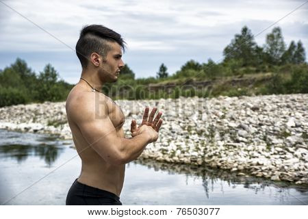 Muscular Shirtless Young Man Outdoor Concentrated