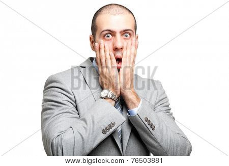 Young man with a shocked facial expression. Isolated on white.