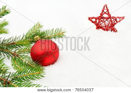 Red Christmas Baubles With Red Star And Needles Fir On Snow