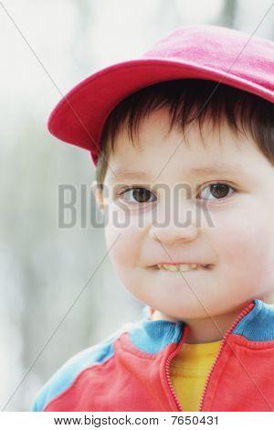 Boy In Red Cap