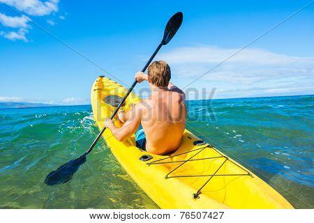 Man Kayaking in the Tropical Ocean