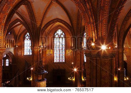 BUDAPEST, HUNGARY - OCT 21 2014 : The Matthias Church nave is lit by windows and electric lights.