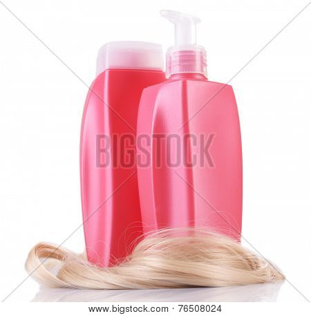 Shampoo and hair conditioner with curly blond hair isolated on white