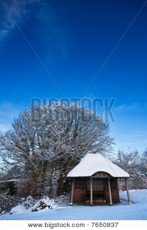 Summerhouse Building In Winter Under Blue Sky