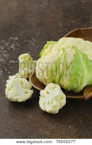 fresh organic white cauliflower on old iron table