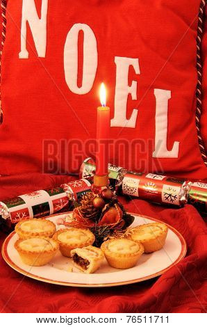 Mince pies with candle.