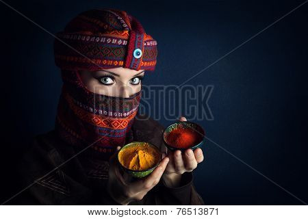 Woman In Turban With Spices
