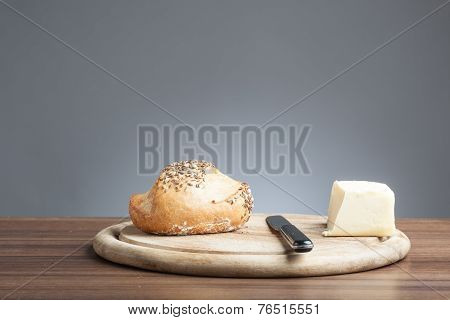 Wholemeal Bread Roll With Caraway Seeds, Butter, Knife