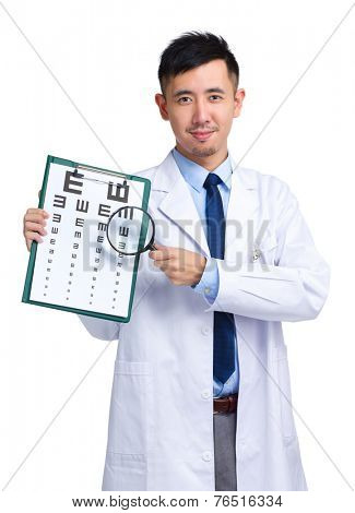 Optician with eye chart and magnifying glasses